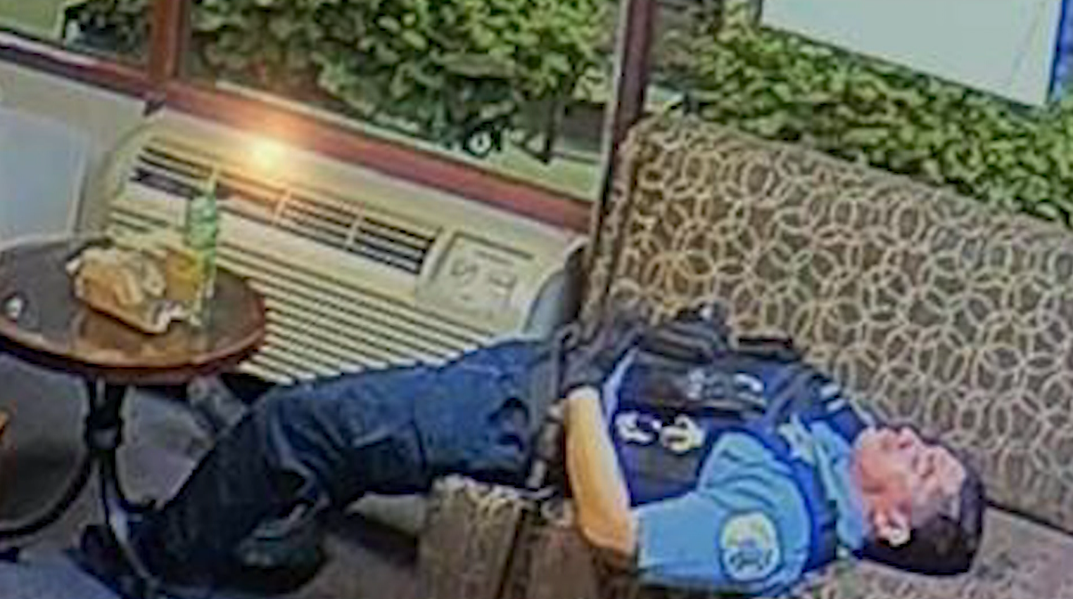 Chicago Police Officers Caught on Video Eating Popcorn, Sleeping While Looting Rage Nearby